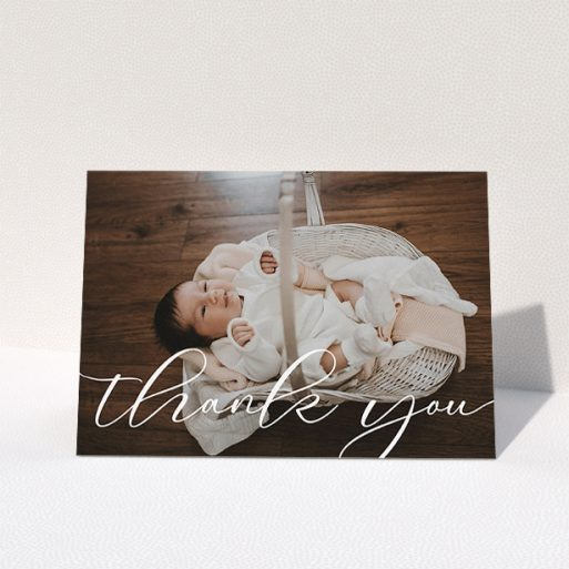 """A christening thank you card design called """"One Photo"""". It is an A5 card in a landscape orientation. It is a photographic christening thank you card with room for 1 photo. """"One Photo"""" is available as a folded card, with mainly white colouring."""