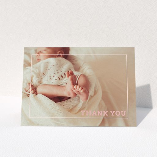 """A christening thank you card design named """"Over Photo Frame"""". It is an A6 card in a landscape orientation. It is a photographic christening thank you card with room for 1 photo. """"Over Photo Frame"""" is available as a folded card, with mainly light pink colouring."""