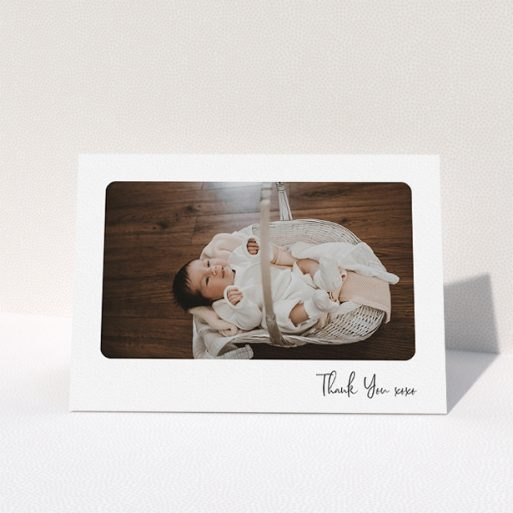 """A christening thank you card template titled """"Rounded Thanks"""". It is an A5 card in a landscape orientation. It is a photographic christening thank you card with room for 1 photo. """"Rounded Thanks"""" is available as a folded card, with mainly white colouring."""