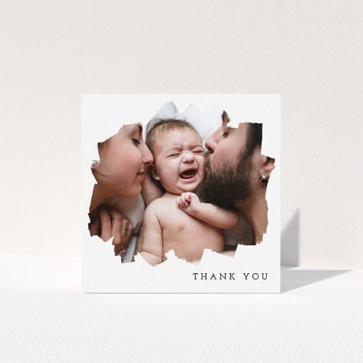 """A christening thank you card named """"Scratched Banner"""". It is a square (148mm x 148mm) card in a square orientation. It is a photographic christening thank you card with room for 1 photo. """"Scratched Banner"""" is available as a folded card, with mainly white colouring."""