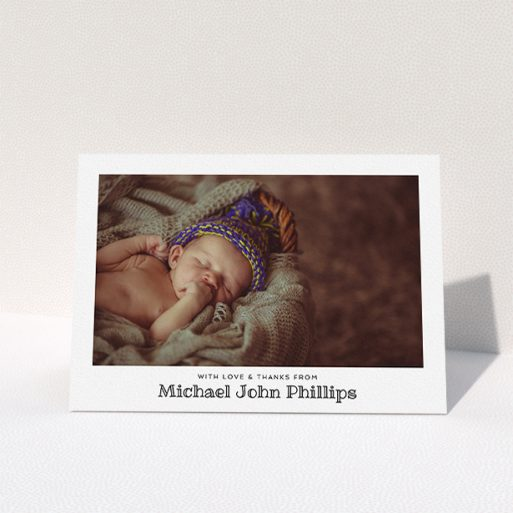 """A christening thank you card named """"Simple Photo Frame"""". It is an A5 card in a landscape orientation. It is a photographic christening thank you card with room for 1 photo. """"Simple Photo Frame"""" is available as a folded card, with mainly white colouring."""