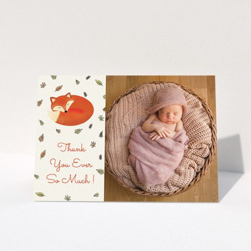 """A christening thank you card template titled """"Sleepy Fox"""". It is an A6 card in a landscape orientation. It is a photographic christening thank you card with room for 1 photo. """"Sleepy Fox"""" is available as a folded card, with tones of cream, orange and light yellow."""