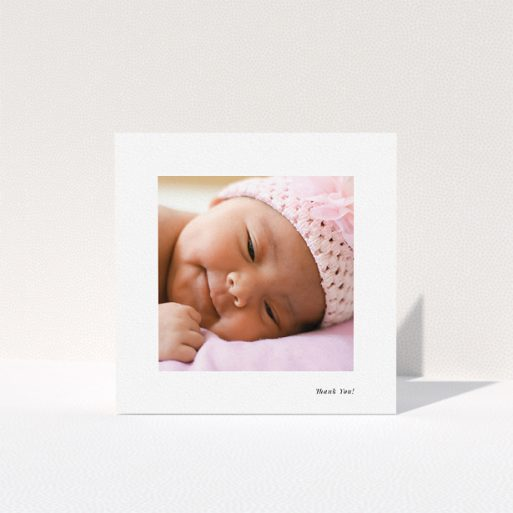 """A christening thank you card design named """"Thank You!"""". It is a square (148mm x 148mm) card in a square orientation. It is a photographic christening thank you card with room for 1 photo. """"Thank You!"""" is available as a folded card, with mainly white colouring."""