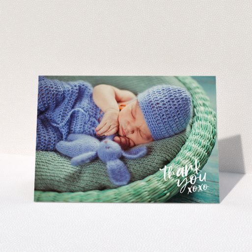 """A christening thank you card design called """"Thanks In the Corner"""". It is an A5 card in a landscape orientation. It is a photographic christening thank you card with room for 1 photo. """"Thanks In the Corner"""" is available as a folded card, with mainly white colouring."""