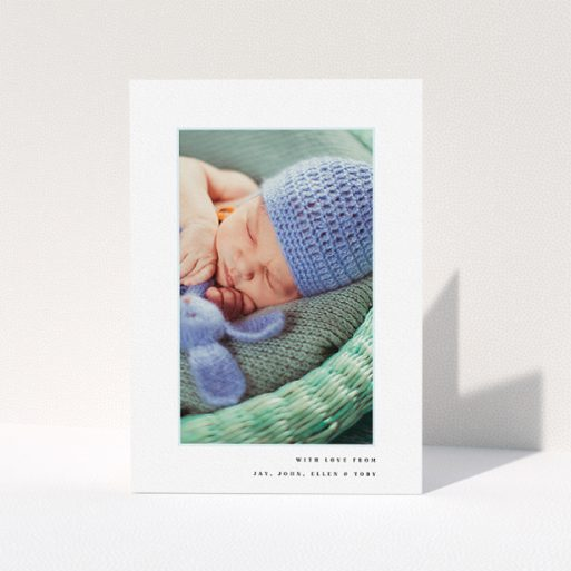 """A christening thank you card named """"Thin Blue Frame"""". It is an A5 card in a portrait orientation. It is a photographic christening thank you card with room for 1 photo. """"Thin Blue Frame"""" is available as a folded card, with tones of white and blue."""