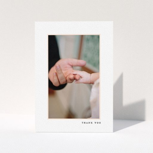 """A christening thank you card template titled """"Thin Pink Frame"""". It is an A6 card in a portrait orientation. It is a photographic christening thank you card with room for 1 photo. """"Thin Pink Frame"""" is available as a folded card, with tones of white and pink."""