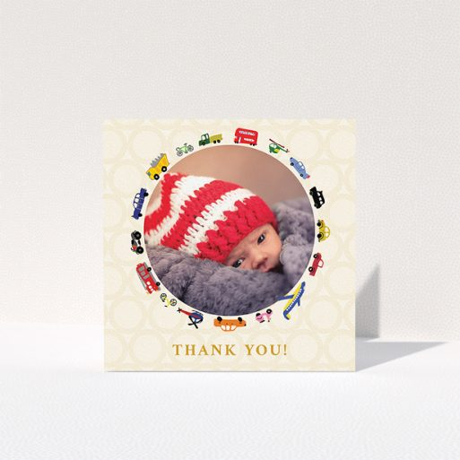 """A christening thank you card design named """"Toy Transport"""". It is a square (148mm x 148mm) card in a square orientation. It is a photographic christening thank you card with room for 1 photo. """"Toy Transport"""" is available as a folded card, with tones of cream, orange and yellow."""