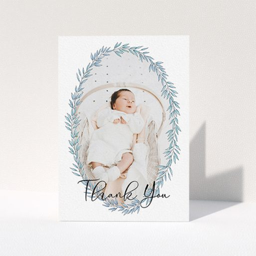 """A christening thank you card design titled """"Tussled Wreath"""". It is an A6 card in a portrait orientation. It is a photographic christening thank you card with room for 1 photo. """"Tussled Wreath"""" is available as a folded card, with tones of blue and white."""