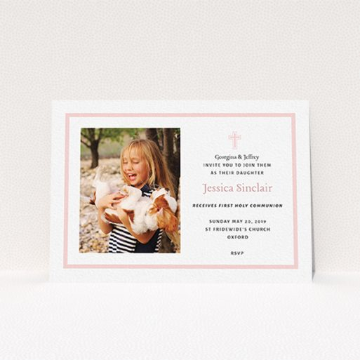 """A communion invitation template titled """"Baby Pink Cross"""". It is an A6 invite in a landscape orientation. It is a photographic communion invitation with room for 1 photo. """"Baby Pink Cross"""" is available as a flat invite, with tones of pink and white."""