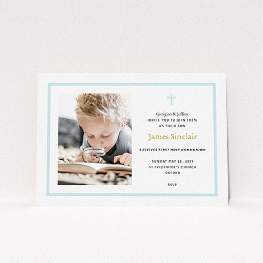 """A communion invite card called """"Baby Blue Cross"""". It is an A6 invite in a landscape orientation. It is a photographic communion invite card with room for 1 photo. """"Baby Blue Cross"""" is available as a flat invite, with tones of blue and white."""