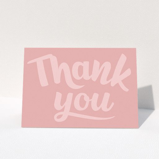 """A communion thank you card design called """"Big Pink Typography"""". It is an A5 card in a landscape orientation. """"Big Pink Typography"""" is available as a folded card, with mainly pink colouring."""