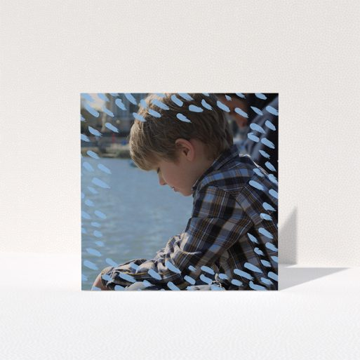 """A communion thank you card called """"Blue Daubs"""". It is a square (148mm x 148mm) card in a square orientation. It is a photographic communion thank you card with room for 1 photo. """"Blue Daubs"""" is available as a folded card, with mainly blue colouring."""
