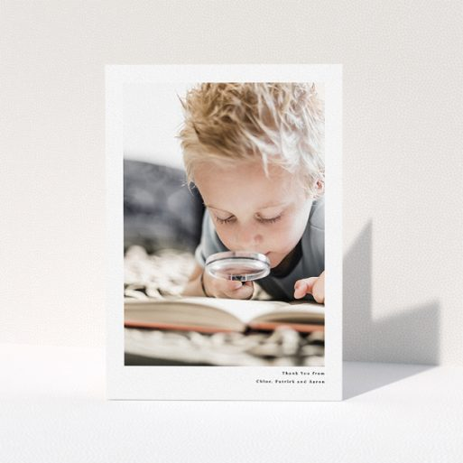 """A communion thank you card named """"Simple Portrait"""". It is an A5 card in a portrait orientation. It is a photographic communion thank you card with room for 1 photo. """"Simple Portrait"""" is available as a folded card, with mainly white colouring."""