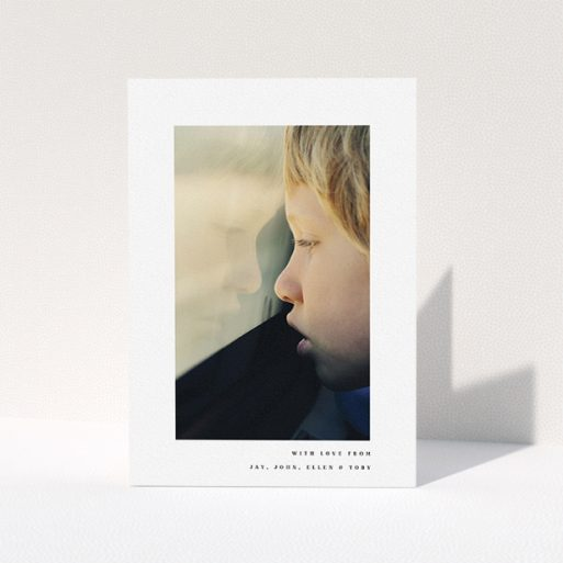 """A communion thank you card called """"Thin Blue Frame"""". It is an A5 card in a portrait orientation. It is a photographic communion thank you card with room for 1 photo. """"Thin Blue Frame"""" is available as a folded card, with mainly white colouring."""