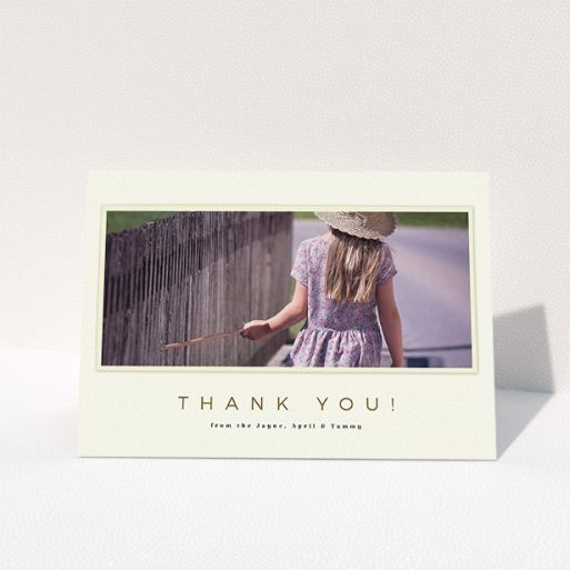 """A communion thank you card design titled """"Torn Cream Frame"""". It is an A5 card in a landscape orientation. It is a photographic communion thank you card with room for 1 photo. """"Torn Cream Frame"""" is available as a folded card, with mainly cream colouring."""
