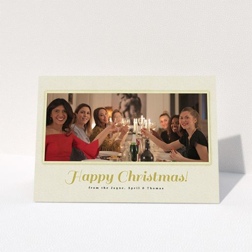 """A custom christmas card design named """"Champagne"""". It is an A6 card in a landscape orientation. It is a photographic custom christmas card with room for 1 photo. """"Champagne"""" is available as a folded card, with mainly cream colouring."""