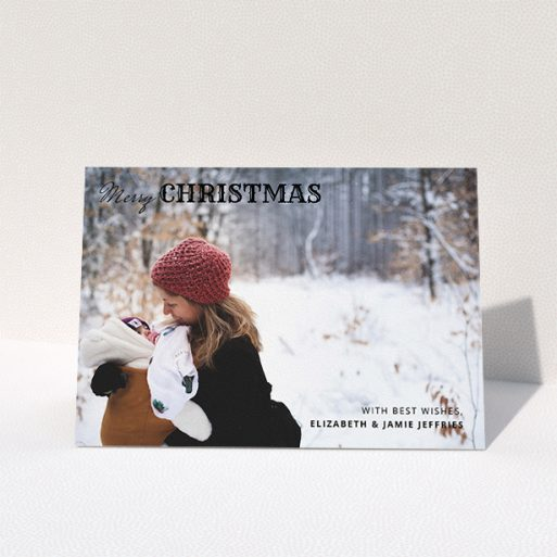 """A custom christmas card design titled """"Christmas Corners"""". It is an A5 card in a landscape orientation. It is a photographic custom christmas card with room for 1 photo. """"Christmas Corners"""" is available as a folded card, with mainly black colouring."""
