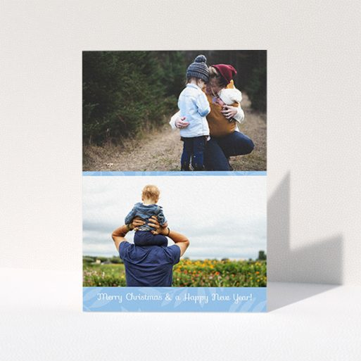 """A custom christmas card design titled """"Christmas Morning"""". It is an A6 card in a portrait orientation. It is a photographic custom christmas card with room for 2 photos. """"Christmas Morning"""" is available as a folded card, with mainly blue colouring."""