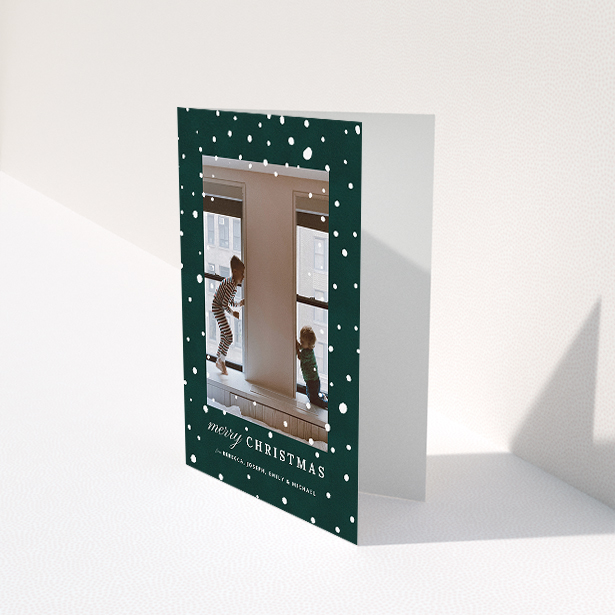"""A custom christmas card called """"Forrest Snow"""". It is an A5 card in a portrait orientation. It is a photographic custom christmas card with room for 1 photo. """"Forrest Snow"""" is available as a folded card, with mainly green colouring."""