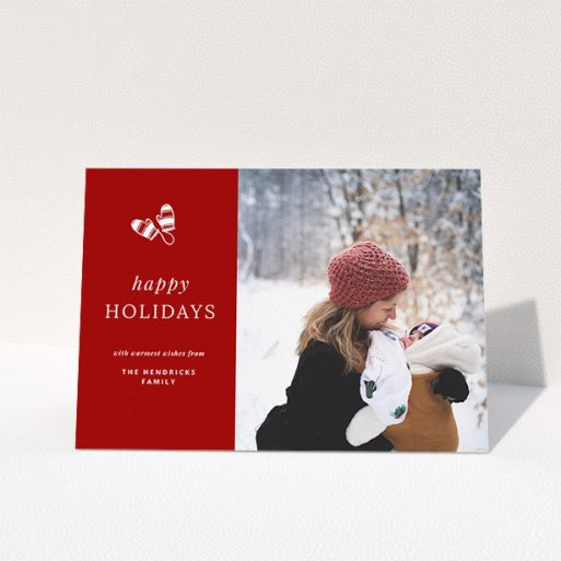 """A custom christmas card design named """"Warm Mittens"""". It is an A5 card in a landscape orientation. It is a photographic custom christmas card with room for 1 photo. """"Warm Mittens"""" is available as a folded card, with tones of red and white."""