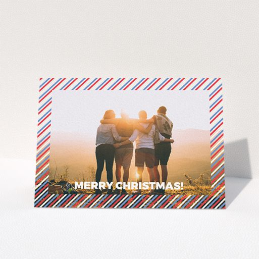 """A family christmas card called """"Bold Christmas Border"""". It is an A6 card in a landscape orientation. It is a photographic family christmas card with room for 1 photo. """"Bold Christmas Border"""" is available as a folded card, with mainly white colouring."""
