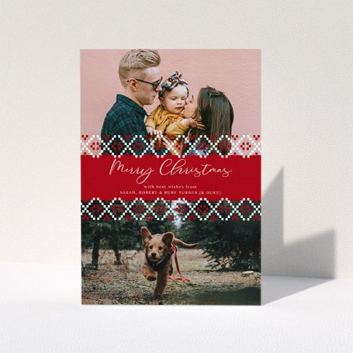 """A family christmas card design titled """"Christmas Jumper Stitch"""". It is an A5 card in a portrait orientation. It is a photographic family christmas card with room for 2 photos. """"Christmas Jumper Stitch"""" is available as a folded card, with tones of red and white."""