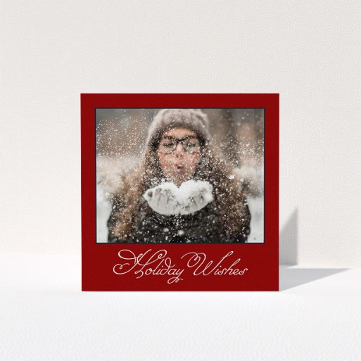 """A family christmas card template titled """"Fanned Deep Red"""". It is a square (148mm x 148mm) card in a square orientation. It is a photographic family christmas card with room for 1 photo. """"Fanned Deep Red"""" is available as a folded card, with tones of burgundy and white."""