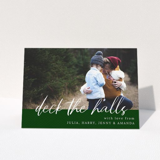 """A family christmas card called """"Forrest Green Feelings"""". It is an A5 card in a landscape orientation. It is a photographic family christmas card with room for 1 photo. """"Forrest Green Feelings"""" is available as a folded card, with mainly green colouring."""