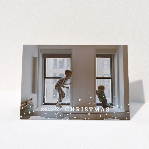 """A family christmas card design called """"Handdrawn"""". It is an A5 card in a landscape orientation. It is a photographic family christmas card with room for 1 photo. """"Handdrawn"""" is available as a folded card, with mainly white colouring."""