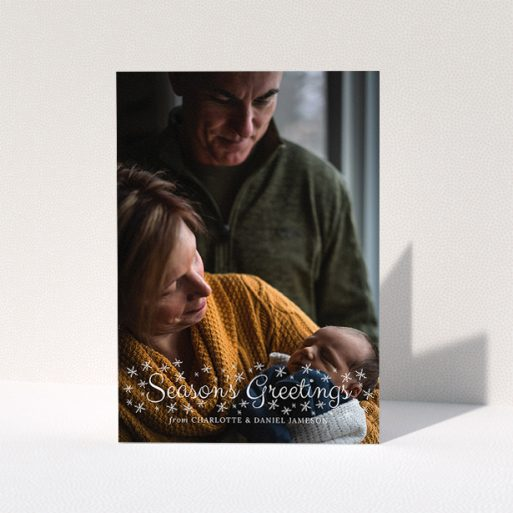 """A family christmas card template titled """"Sparkling Snow"""". It is an A5 card in a portrait orientation. It is a photographic family christmas card with room for 1 photo. """"Sparkling Snow"""" is available as a folded card, with mainly white colouring."""
