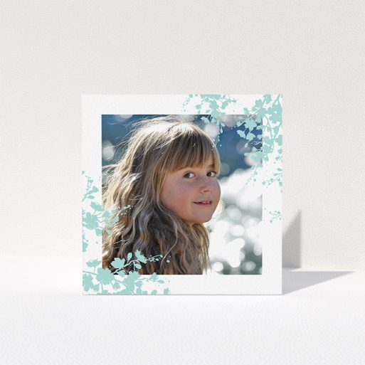 """A first holy communion thank you card called """"Blue Forest Corners"""". It is a square (148mm x 148mm) card in a square orientation. It is a photographic first holy communion thank you card with room for 1 photo. """"Blue Forest Corners"""" is available as a folded card, with tones of green and white."""