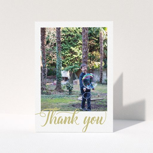 """A first holy communion thank you card design called """"Golden Thank You"""". It is an A6 card in a portrait orientation. It is a photographic first holy communion thank you card with room for 1 photo. """"Golden Thank You"""" is available as a folded card, with tones of cream and gold."""