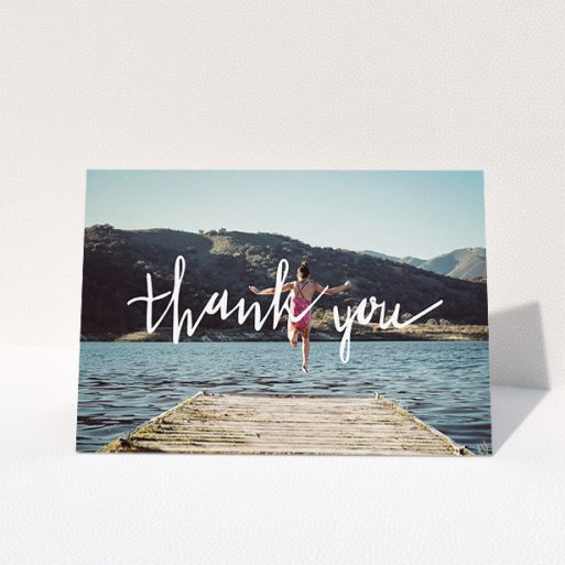 """A first holy communion thank you card named """"Handwritten Thanks"""". It is an A5 card in a landscape orientation. It is a photographic first holy communion thank you card with room for 1 photo. """"Handwritten Thanks"""" is available as a folded card, with mainly white colouring."""