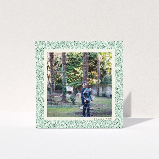 """A first holy communion thank you card named """"Hedgerow Frame"""". It is a square (148mm x 148mm) card in a square orientation. It is a photographic first holy communion thank you card with room for 1 photo. """"Hedgerow Frame"""" is available as a folded card, with tones of green and white."""
