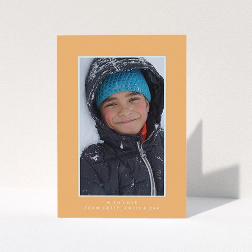 """A first holy communion thank you card named """"Orange and Mint"""". It is an A6 card in a portrait orientation. It is a photographic first holy communion thank you card with room for 1 photo. """"Orange and Mint"""" is available as a folded card, with tones of orange and blue."""