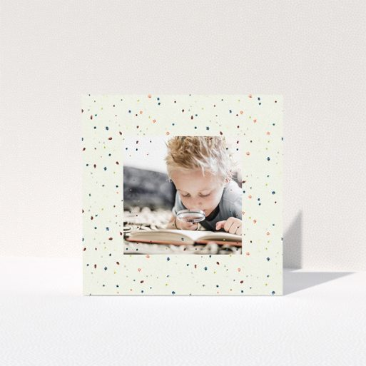 """A first holy communion thank you card design titled """"Pastel Dots"""". It is a square (148mm x 148mm) card in a square orientation. It is a photographic first holy communion thank you card with room for 1 photo. """"Pastel Dots"""" is available as a folded card, with mainly cream colouring."""