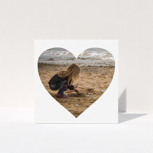 """A first holy communion thank you card called """"Simple Heart Frames"""". It is a square (148mm x 148mm) card in a square orientation. It is a photographic first holy communion thank you card with room for 1 photo. """"Simple Heart Frames"""" is available as a folded card, with mainly white colouring."""