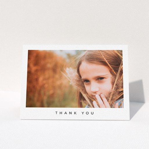 """A first holy communion thank you card design called """"Simple Thanks"""". It is an A6 card in a landscape orientation. It is a photographic first holy communion thank you card with room for 1 photo. """"Simple Thanks"""" is available as a folded card, with mainly white colouring."""