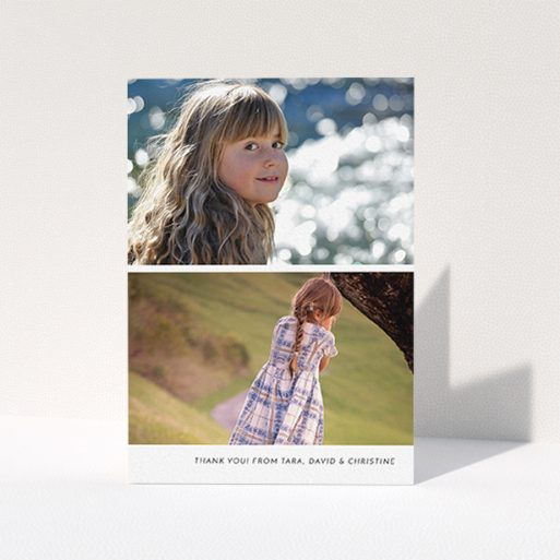 """A first holy communion thank you card called """"Stacked Landscapes"""". It is an A6 card in a portrait orientation. It is a photographic first holy communion thank you card with room for 2 photos. """"Stacked Landscapes"""" is available as a folded card, with mainly white colouring."""