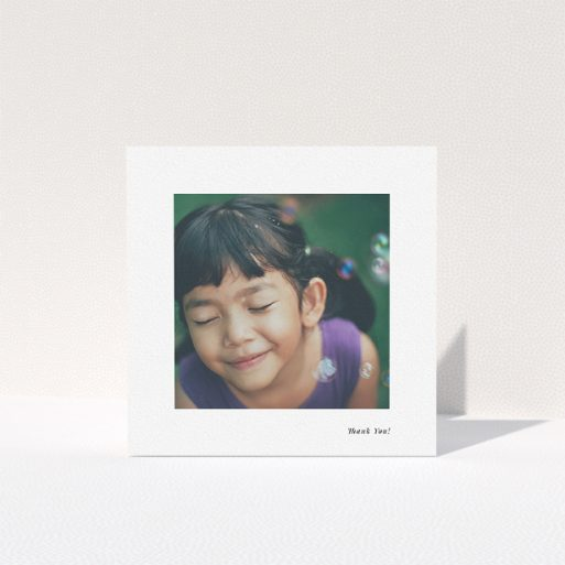 """A first holy communion thank you card named """"Thank You!"""". It is a square (148mm x 148mm) card in a square orientation. It is a photographic first holy communion thank you card with room for 1 photo. """"Thank You!"""" is available as a folded card, with mainly white colouring."""