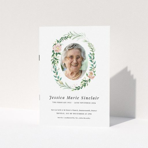 """A funeral order of service named """"Floral celebration. It is an A5 booklet in a portrait orientation. It is a photographic funeral program with room for 1 photo. """"Floral celebration"""" is available as a folded booklet booklet, with tones of white, light pink and green."""
