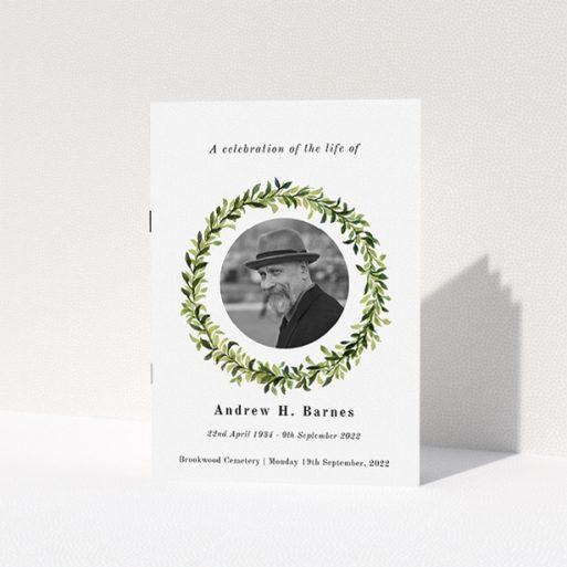"""A funeral order of service named """"Solemn wreath. It is an A5 booklet in a portrait orientation. It is a photographic funeral program with room for 1 photo. """"Solemn wreath"""" is available as a folded booklet booklet, with tones of white and green."""
