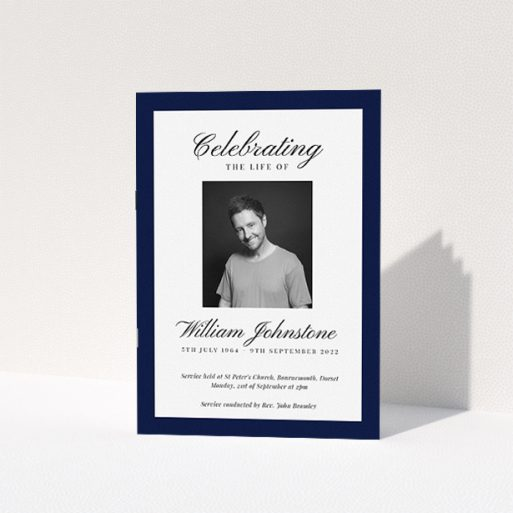 """A funeral order of service named """"Stoic Border. It is an A5 booklet in a portrait orientation. It is a photographic funeral order of service with room for 1 photo. """"Stoic Border"""" is available as a folded booklet booklet, with tones of white and navy blue."""