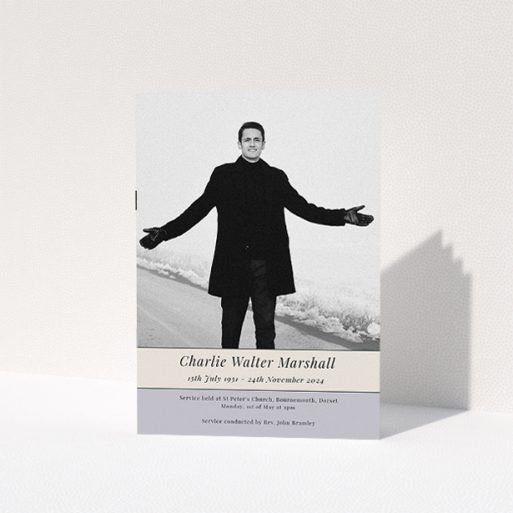 """A funeral order of service named """"Beige and cream banner. It is an A5 booklet in a portrait orientation. It is a photographic funeral program with room for 1 photo. """"Beige and cream banner"""" is available as a folded booklet booklet, with tones of yellow, purple and cream."""
