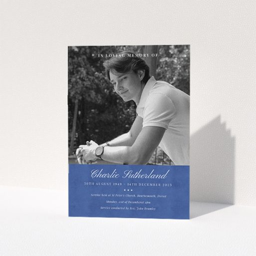 """A funeral order of service named """"Bold Elegance. It is an A5 booklet in a portrait orientation. It is a photographic funeral program with room for 1 photo. """"Bold Elegance"""" is available as a folded booklet booklet, with splashes of navy blue."""