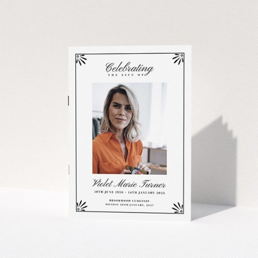 """A funeral order of service named """"Deco Corners. It is an A5 booklet in a portrait orientation. It is a photographic funeral order of service with room for 1 photo. """"Deco Corners"""" is available as a folded booklet booklet, with tones of white and black."""