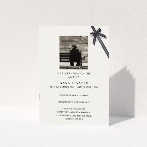 """A funeral ceremony program template titled """"Peacefully tied"""". It is an A5 booklet in a portrait orientation. It is a photographic funeral ceremony program with room for 1 photo. """"Peacefully tied"""" is available as a folded booklet booklet, with tones of pale cream and faded black."""