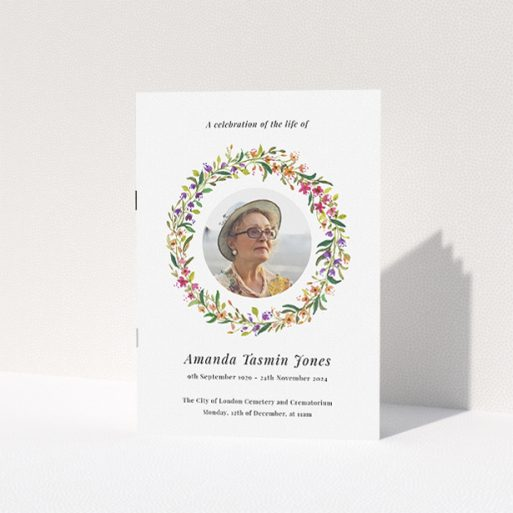 """A funeral order of service named """"Bright Florals. It is an A5 booklet in a portrait orientation. It is a photographic funeral program with room for 1 photo. """"Bright Florals"""" is available as a folded booklet booklet, with tones of yellow, light pink and orange."""