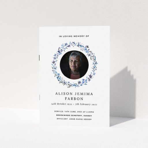 """A funeral order of service named """"Blue Floral. It is an A5 booklet in a portrait orientation. It is a photographic funeral program with room for 1 photo. """"Blue Floral"""" is available as a folded booklet booklet, with tones of blue, light blue and purple."""