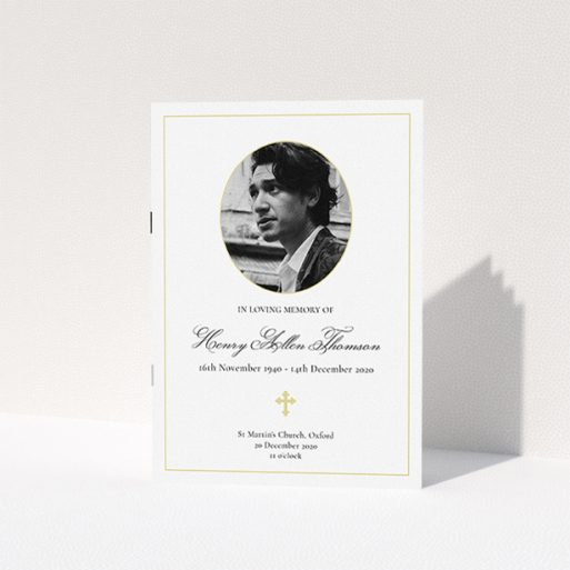 """A funeral order of service named """"Elegant Cross. It is an A5 booklet in a portrait orientation. It is a photographic funeral order of service with room for 1 photo. """"Elegant Cross"""" is available as a folded booklet booklet, with tones of yellow, gold and cream."""